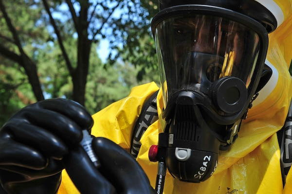 Air Force Maj. Michael Smith secures a simulated sample of Staphylococcal Enterotoxin B during an integrated base emergency response capabilities training exercise at Seymour Johnson Air Force Base, N.C., June 25, 2015. Air Force photo by Senior Airman John Nieves Camacho