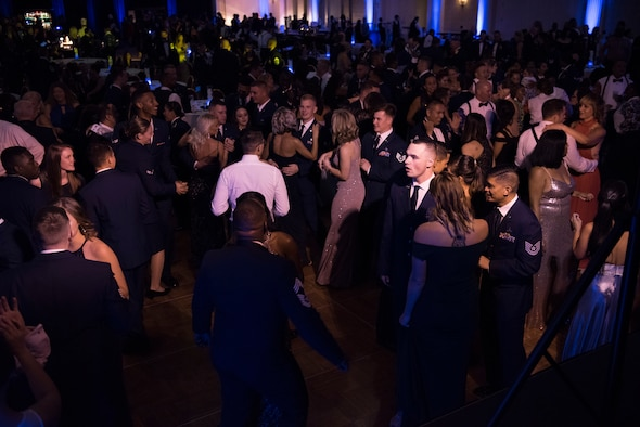 "Members of Team Dover dance Sept. 15, 2018, during the Air Force Ball in Dover, Del. The event's theme, ""Eve of Tomorrow,"" celebrated the 71st birthday of the world's greatest Air Force, encouraging participants to remember the heritage and look toward the future. (U.S. Air Force photo by Staff Sgt. Aaron J. Jenne)"