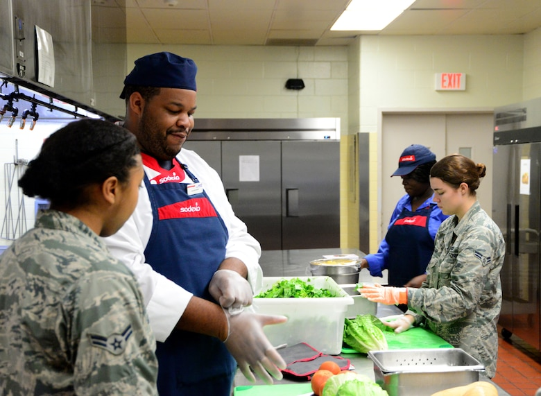 From left, Airman First Class Iyana Green, 436th Force Support Squadron food service apprentice, Hassan Amenu-el, line cook, Shemya Singletary, Sodexo supervisor, and Airman 1st Class Katie Magar, 436th Force Support Squadron food service apprentice, work to prepare lunch Sept. 14, 2018, at the Patterson Dining Facility on Dover Air Force Base, Del. Preparing fresh food each day is one of the practices the DFAC uses to maintain quality standards for the food they serve. (U.S. Air Force photo by Airman 1st Class Dedan Dials)