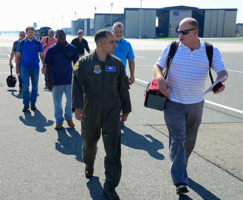 Master Sgt John Crowe, 9th Arilift Squadron loadmaster, leads a group of engineers and logisiticans from Marine Corps Systems Command land system defense to a C-17 Globemaster III aitcraft Sept. 5, 2018 at Dover Air Force Base, Del. The engineers and logisticians are tasked with finding more equipment that makes the US Marine Corps more leathal.(U.S. Air Force photo by Airman First Class Jonathan Harding)