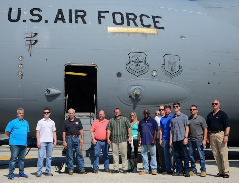 Members from Marine Corps Systems Command land systems defense acquisition engineers and logisiticians pose for a picture in front of a C-17 III Globemaster Sept 5. 2018, Dover Air Force Base, Del. The ratio of active duty members to civillians in MARCORSYSCOM is 1-to-6, with 50 active duty members and 300 civillian members (U.S. Air Force photo by Airman 1st Class Jonathan Harding.)
