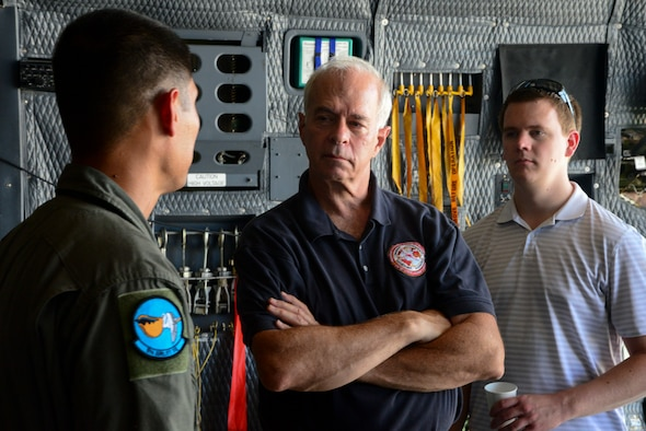 A loadmaster speaks with two members from Marine Corps Systems Command land systems defense acquisition team Sept 5. 2018, at Dover Air Force Base. The Marine Corps is constantly looking for ways to move more equipment while constantly decreasing cost (U.S. Air Force photo by Airman First Class Jonathan Harding)
