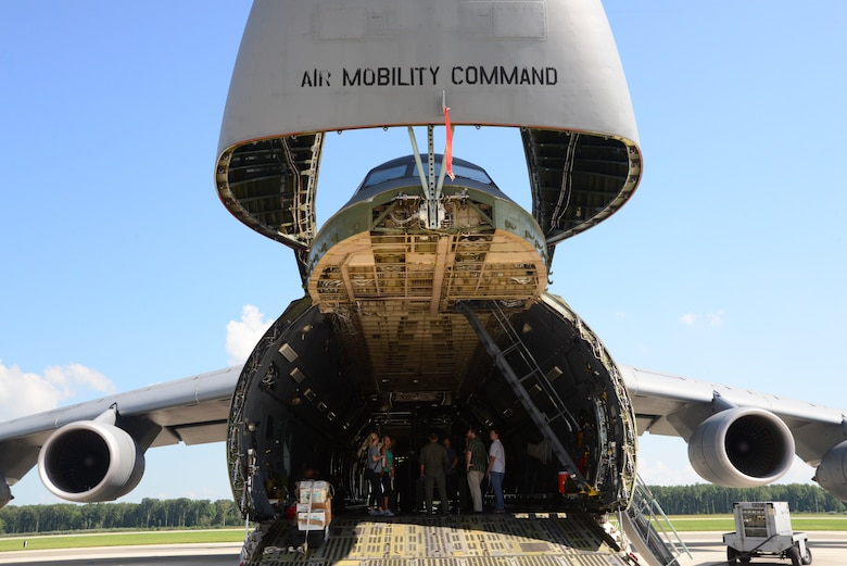 Loadmasters and members of the Marine Corps Systems Command land systems defense acquisition team discuss airlift operations aboard a static C-5M Super Galaxy Sept 5, 2018, at Dover Air Force Base, Del. MARCORSYSCOM is responsible for equipment development. Their visit to Dover AFB was intended to improve their partnership with Air Force loadmasters, who are responsible for movine Marine Corps equipment to the warfighter. (U.S. Air Force photo by Airman First Class Jonathan Harding)