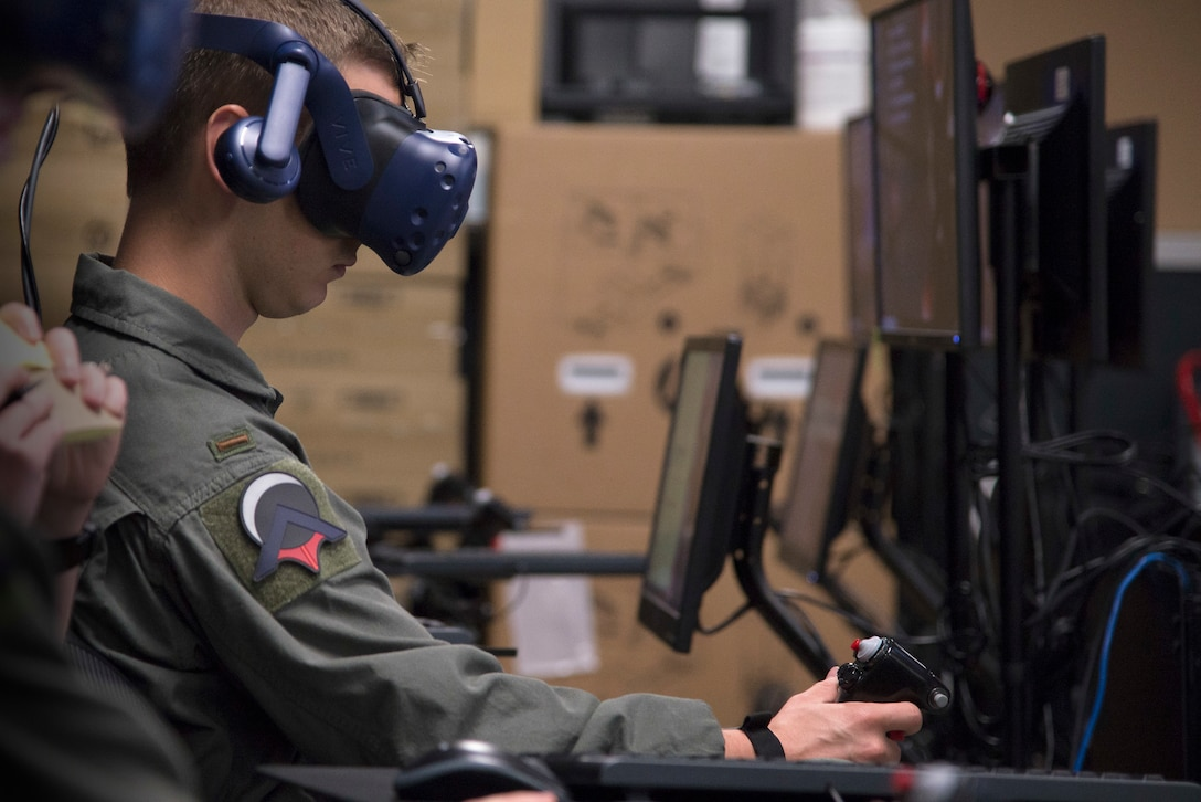 U.S. Air Force Second Lt. Austin Sneed, Pilot Training Next student, trains on a virtual reality flight simulator at the Armed Forces Reserve Center in Austin, Texas, June 18, 2018. Air Education and Training Command officials announced the second iteration of Pilot Training Next would begin in January 2019 during a panel at the 2018 Air Force Association Air, Space and Cyber Conference in National Harbor, Maryland. (U.S. Air Force photo by Sean M. Worrell)