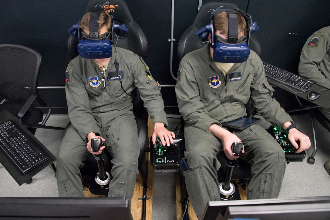 U.S. Air Force Second Lt. Charles Keller and Airman First Class Tyler Haselden, Pilot Training Next students, train on a virtual reality flight simulator at the Armed Forces Reserve Center in Austin, Texas, June 21, 2018. Air Education and Training Command officials announced the second iteration of Pilot Training Next would begin in January 2019 during a panel at the 2018 Air Force Association Air, Space and Cyber Conference in National Harbor, Maryland. (U.S. Air Force photo by Sean M. Worrell)