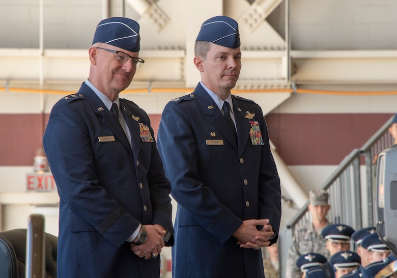 Maj. Gen. Sam Barrett (left), 18th Air Force commander, presides over the 60th Air Mobility Wing assumption of command ceremony at Travis Air Force Base, Calif., Sept. 18, 2018. Col. Jeff Nelson (right), assumed command of Air Mobility Command's largest wing. (U.S. Air Force photo by Heide Couch)