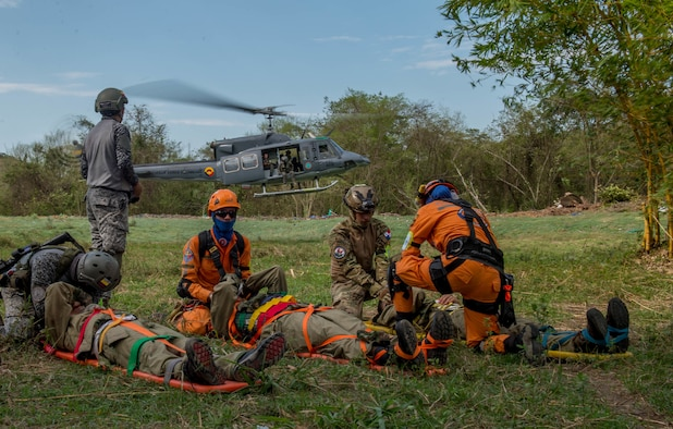 Triage patients wait to be air evacuated on a Colombian Bell 212 helicopter during a simulation as part of the multilateral exercise Angel de los Andes Sept. 6, 2018 at German Olano Air Base, Colombia. The simulation focused on aeromedical evacuation and casualty evacuation operations. (U.S. Air Force photo by Staff Sgt. Robert Hicks)