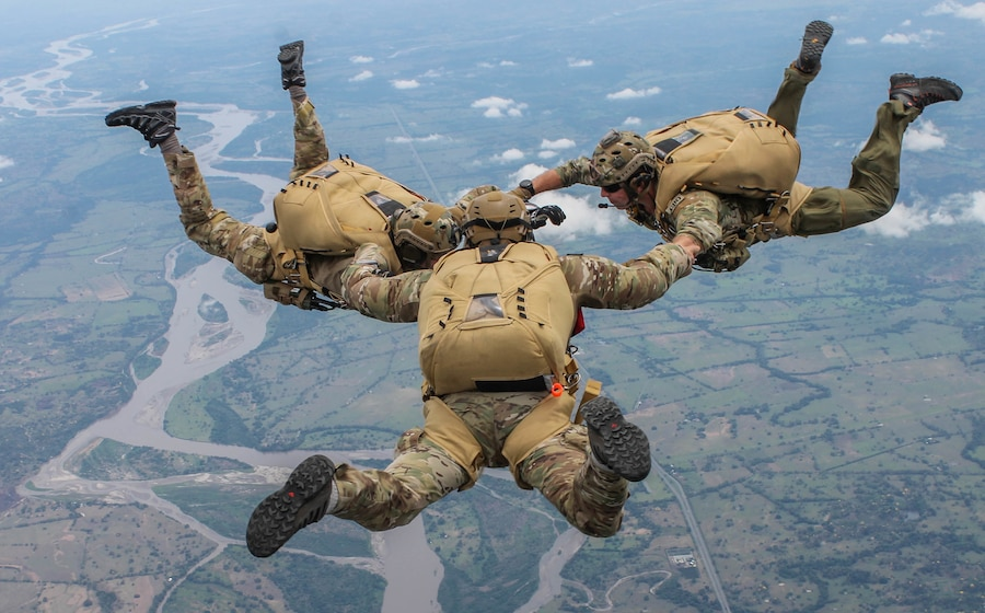 U.S. Air Force pararescuemen jump out of a Colombian Costa 295 aircraft during a multi-national jump with Colombian, Peruvian and Dominican special operations forces during exercise Angel de los Andes, Sept. 4, 2018. Angel de los Andes is a search and rescue exercise hosted by Colombia involving 12 partner nations working together in a multi-national environment and focuses on exercising search and rescue, aeromedical evacuation and casualty evacuation operations. (Courtesy Photo)