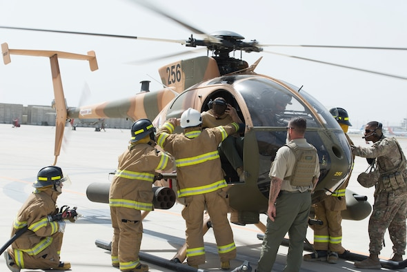 AAF Firefighters Conduct MD-530 Egress training