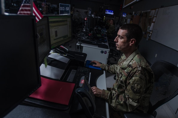 An Airman assigned to the 609th Air Operations Center works on the combat operations division floor at the Combined Air Operations Center at Al Udeid Air Base, Qatar, June 16, 2017. Despite Hurricane Florence hitting South Carolina last week, Airmen assigned to the 609th AOC Detachment 1 at Shaw Air Force Base, South Carolina, continued operations without interruption in support of U.S. Central Command military operations. AFCENT has adopted a distributed command and control model for operations, meaning organizations at multiple locations enable combat operations. (U.S. Air Force photo by Staff Sgt. Alexander W. Riedel)