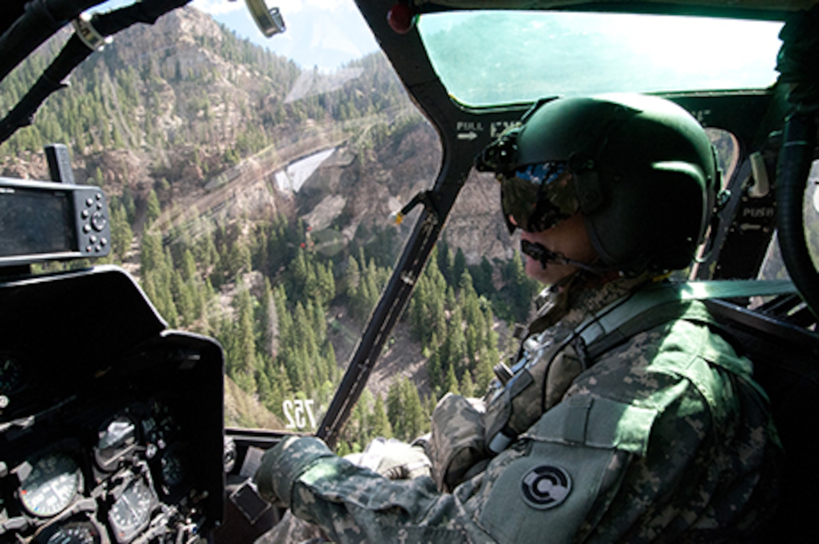 Colorado Army National Guard Maj. Tony Somogyi pilots his OH-58 Kiowa helicopter above the Rocky Mountains, Aug. 23, 2011. Somogyi is the executive officer of the COARNG's High-altitude Army National Guard Aviation Training Site in Gypsum, Colo. Somogyi has extensive experience as a scout and as a search-and-rescue/search-and-recovery pilot. (Photo © 2011 Deborah Grigsby Illustrative Photography/Used with permission)