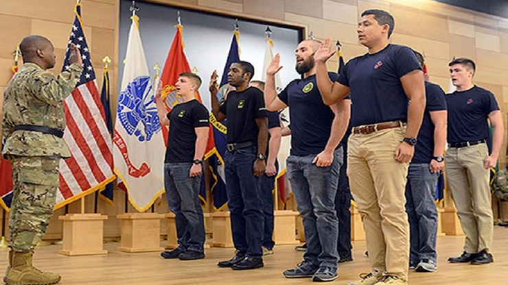 U.S. Army Soldier enlists service members.