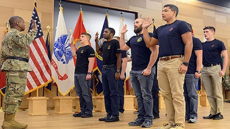 U.S. Army Soldier enlists service members.