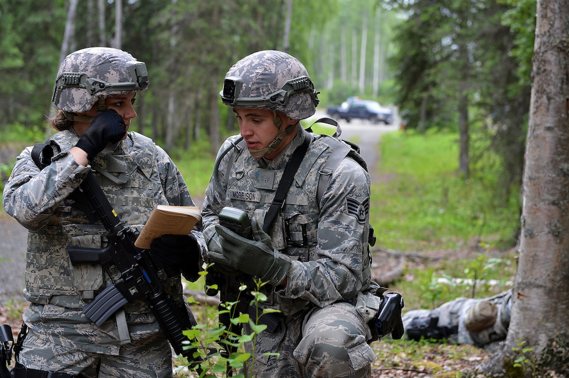 Airman 1st Class Shannon Costello and Staff Sergeant Michael Morrison, security forces specialists with the 155th Security Forces Squadron from the 155th Air Refueling Wing, Nebraska, report in an Improvised Explosive Device durning an IED awareness training exercise June 22, 2017, at Joint Base Elmendorf-Richardson, Alaska.