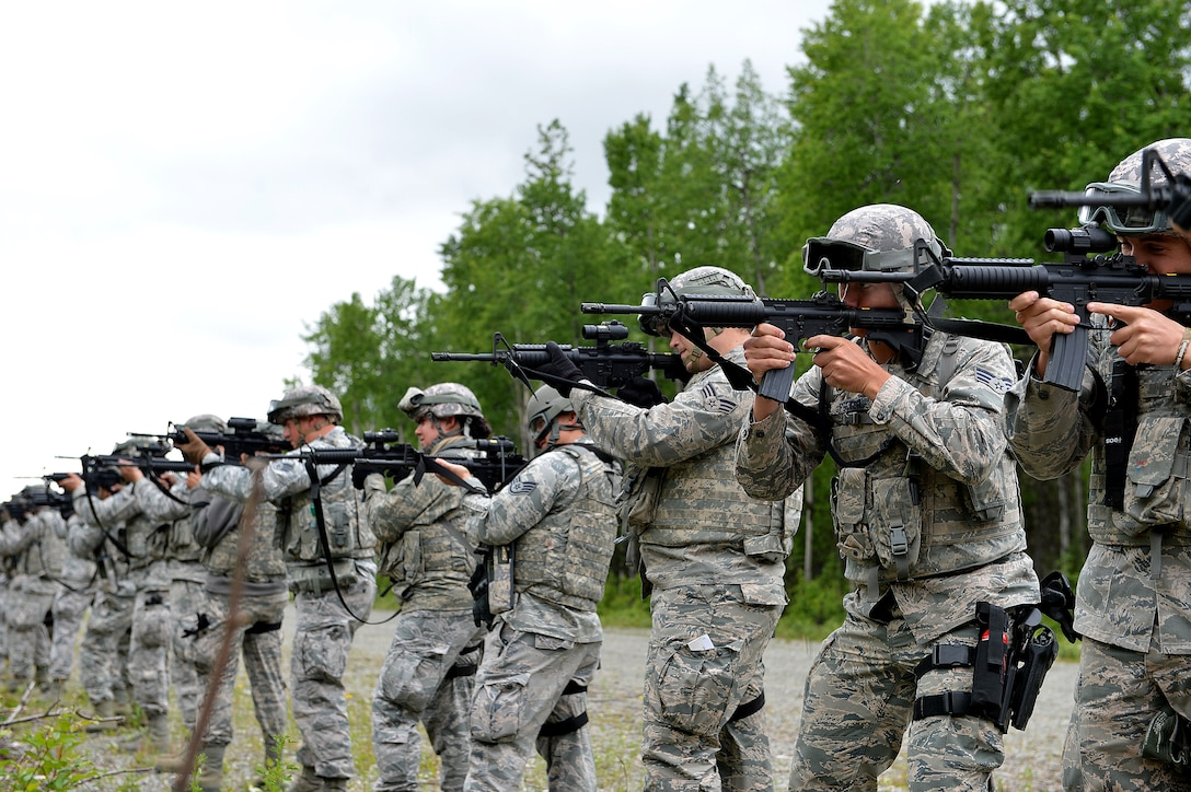 Airmen with the 155th Security Forces Squadron from the 155th Air Refueling Wing, Nebraska, test their weapons before a Shoot, Move, and Communicate exercise June 22, 2017, at Joint Base Elmendorf-Richardson, Alaska.   (U.S. Air Force photo taken by Airman 1st Class Jamie Titus/ Released)