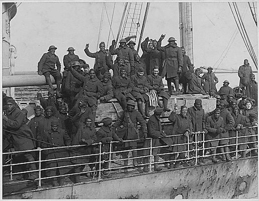 Soldiers of the New York Army National Guard's 369th Infantry Regiment arrive back in New York harbor on Feb. 12, 1919, after serving in France during World War I. The 369th was an African-American unit in a segregated Army which had served under French Army command but earned so many awards for heroism that they became known as the Harlem Hellfighters.