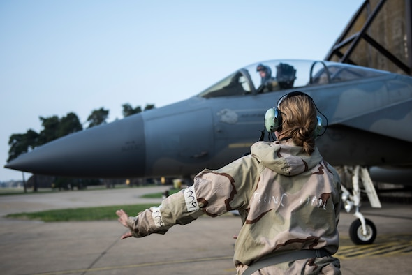 An Airman assigned to the 48th Maintenance Group sends off an F-15C Eagle for a sortie while in Mission Oriented Protective Posture gear during Combat Thursday at Royal Air Force Lakenheath, England, Sept. 6, 2018. Readiness remains a major focus of U.S. Air Force leadership, and is being fully integrated into operations with the 48th Fighter Wing's top priorities and vision for the future at Royal Air Force Lakenheath, England. (U.S. Air Force photo/Senior Airman Malcolm Mayfield)