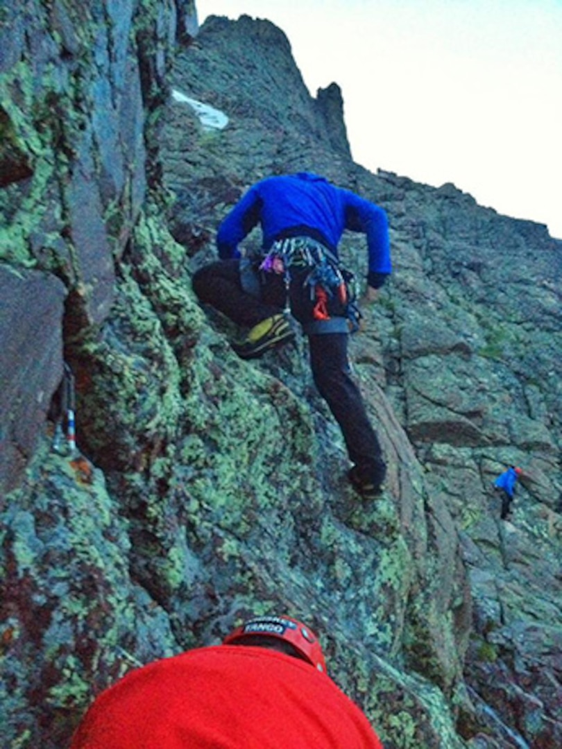 Civilian search-and-rescue personnel from Custer County Search & Rescue, Saguache County Search & Rescue, and Western Mountain Rescue Team, climb to reach Jennifer Tatnall Staufer, an experienced mountaineer who survived a 150-foot fall down Crestone Peak in the Sangre de Cristo Range in southern Colorado, July 11, 2015.