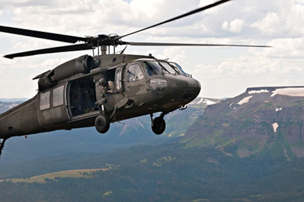 Active duty Army Chief Warrant Officer 3 Jonathan Licuanan and Chief Warrant Officer 3 Ryan Mahany take turns piloting a UH-60 Black Hawk in the Rocky Mountains of Colorado, while following the directions of their instructor pilot, Colorado Army National Guard Chief Warrant Officer 4 Mark Grayson, Aug. 25, 2011. Licuanan and Mahany are students at the COARNG's High-altitude Army National Guard Aviation Training Site in Gypsum, Colo. Mahany has already flown in Afghanistan and Iraq and wishes he would have had this type of training prior to his deployments. (Photo © 2011 Deborah Grigsby Illustrative Photography/Used with permission)