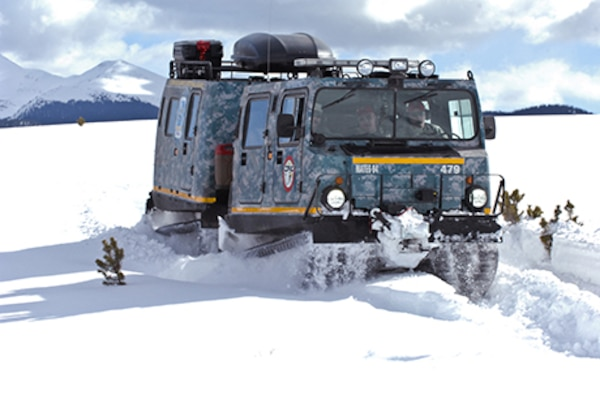 An M973A1 Small Unit Support Vehicle , aka SUSV, clad in emergency lights and digital camouflage, claws its way through the snow at Taylor Park Reservoir near Gunnison, Colo., March 15, 2010. The SUSV, which is capable of traversing almost any terrain, is the primary vehicle used by the Colorado Army National Guard's Snow Response Team. This relatively unknown asset can be used by the SRT to assist state and local rescue teams during nearly every type of disaster, state emergency or search and rescue. (Official U.S. Army photo by Spc. Joseph K. VonNida, Colorado National Guard/RELEASED)