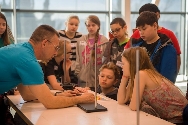 Steve Mastel, one of the coordinators for Puget Sound Naval Shipyard & Intermediate Maintenance Facility's science, technology, engineering and mathematics outreach program, talks with students about frequency generators during a Navy STEM day at the Puget Sound Navy Museum in Bremerton, Wash. PSNS & IMF's STEM outreach program was recently selected for a 2018 Community Service Award from Navy Region Northwest.