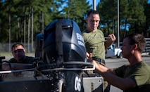 A Marine with 3rd Force Reconnaissance Company, 4th Marine Division, turns on a F470 Combat Rubber Raiding Craft engine at the McCrady Training Center, South Carolina, Sept. 18, 2018, in preparation to respond to Hurricane Florence.