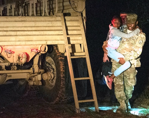 South Carolina Army National Guard Soldiers with the 1053rd Transportation Company assist a family that was trapped inside their vehicle during the early morning hours as a result of flood waters on the roadway in Hamer, South Carolina, Sept. 18.
