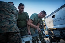Marines with 3rd Force Reconnaissance Company, 4th Marine Division, unhook a trailer full of Combat Rubber Raiding Crafts at the McCrady Training Center, South Carolina, Sept. 18, 2018, in preparation to respond to Hurricane Florence.