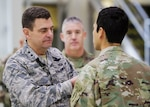 The Adjutant General of Colorado U.S. Air Force Maj. Gen. Mike Loh pins a medal on a 5th Battalion 19th Special Forces Group member at a Valor Ceremony, Feb. 10, 2018, following the units recent return.