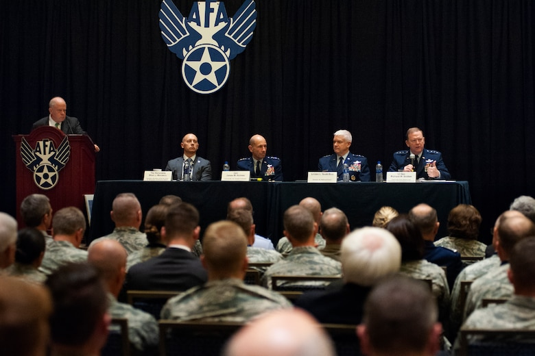A panel consisting of (from left) Assistant Secretary of the Air Force for Manpower and Reserve Affairs, Shon J. Manasco, the Commander of Air Combat Command Gen. James M. Holmes, Director of the Air National Guard Lt. Gen. L. Scott Rice, and Chief of the Air Force Reserve and Commander Air Force Reserve Command Lt. Gen. Richard W. Scobee, participate in a total force integration panel during the Air Force Association Air, Space and Cyber Conference Sept. 18, 2018, in National Harbor, Md. The panel discussed ways to improve processes and better integrate Guard and Reserve Airmen into operations. (U.S. Air Force photo by Andy Moratay)