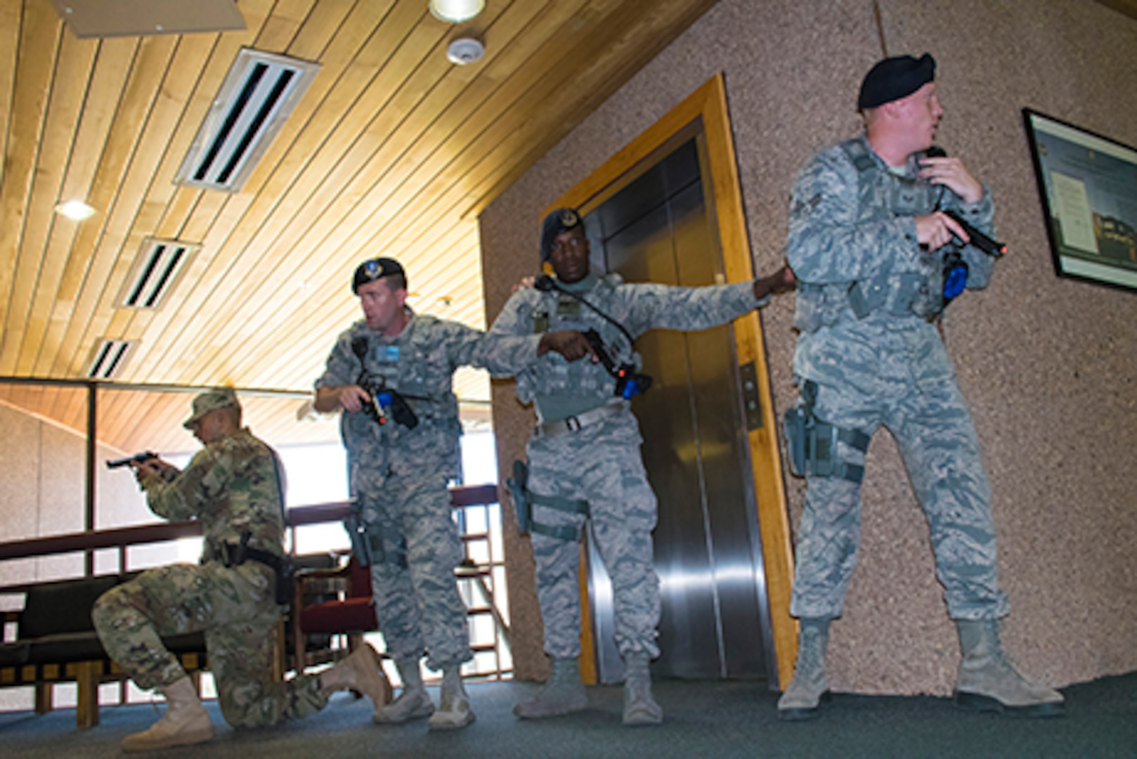 Members of the Colorado National Guard, South Metro Fire Rescue and the Arapahoe County Sheriffs Office perform active threat training at Joint Force Headquarters, Centennial, Colo., August 25, 2017.  This training aids the CONG and partner organizations in preparation to response to potential real world incidents and educates Department of Military and Veterans Affairs employees on survival tactics. (U.S. Army National Guard photo by Staff Sgt. Joseph K. VonNida)