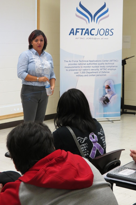 Diana Velosa, a chemist with the Air Force Technical Applications Center, Patrick AFB, Fla., talks about career opportunities with high school students attending STEMversity in Milledgeville, Ga. Velosa spends a good deal of her time, both on and off duty, mentoring students in forensic science and math as part of the organization's STEM/diversity outreach program.  (U.S. Air Force photo by Rose Day)