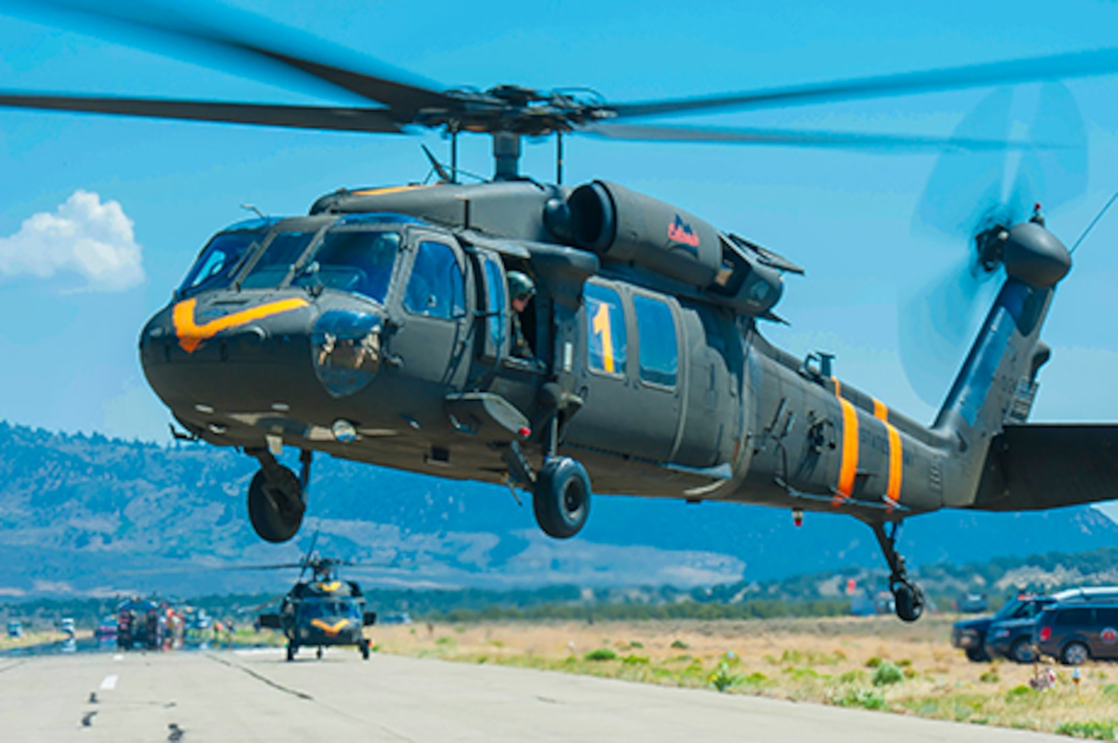 Two UH-60 Black Hawk helicopter crews with aircraft, equipped with aerial water buckets, from the Chief Warrant Officer 5 David R. Carter Army Aviation Support Facility based at Buckley Air Force Base, Aurora, Colorado, depart the Spring Fire helibase, in Fort Garland, Colo., to support fire suppression efforts July 6, 2018. The team arrived and began operations July 2.  The CONG has supported the Spring Fire since July 1, 2018, providing capabilities to include: security personnel for traffic control points and roving patrols; two UH-60 Black Hawk helicopter crews and aircraft each equipped with aerial water buckets; geological information system operators; as well as, refueling crews with Heavy Expanded Mobility Tactical refueling trucks and firefighters with HEMTT firefighting vehicles.  The CONG has been providing an aviation search and rescue standby capability in support of the Rocky Mountain Area Coordination Center since July 1. The High-Altitude Army National Guard Aviation Training Site facility in Gypsum, Colorado, is supporting the mission which is rapid response to aviation search and rescue missions, primarily for firefighter safety, in support of multiple wildfire responses throughout Colorado.  On order of the Governor, the standing Joint Task Force - Centennial commands and integrates CONG forces to support civil authorities in assisting Colorado, or supported states, during times of crisis and disaster, to save lives, prevent suffering, and mitigate great property damage.  (U.S. Air National Guard photo by Tech. Sgt. Nicole Manzanares)