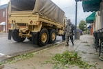 South Carolina National Guard Soldiers and Bennettsville, S.C., law enforcement work together to help the local community evacuate as flooding caused by Tropical Storm Florence forces people from their home, Sept.16, 2018. Approximately 3,400 Soldiers and Airmen have been mobilized to prepare, respond and participate in recovery efforts as Tropical Storm Florence has caused flooding and damage to the state.
