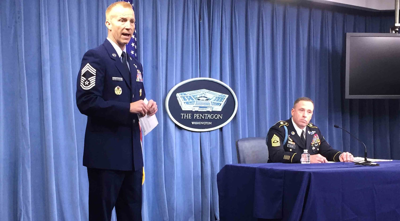 Air Force Chief Master Sgt. Michael D. Noel, left, introduces Army Sgt. Maj. Jason Wilson, right, who spoke about the Close-Combat Lethality Task Force at the Pentagon.