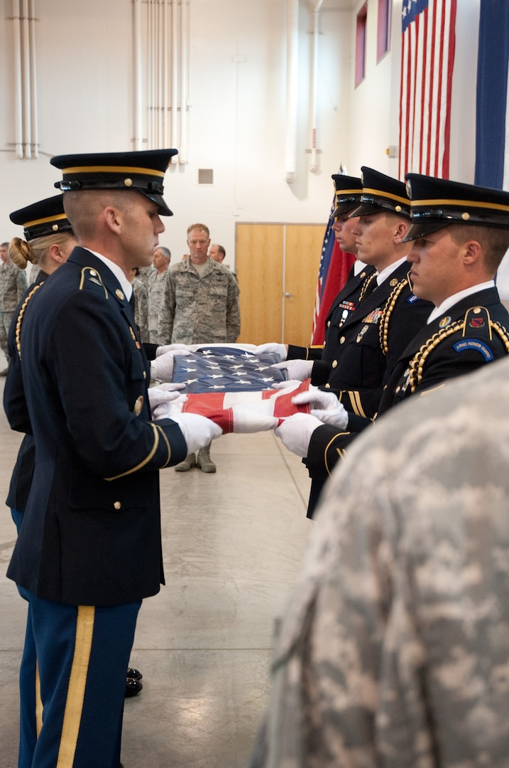 Colorado National Guard members hold a memorial retreat in honor of those who have given the ultimate sacrifice in the Global War on Terror, April 15, 2012, at the CONG state headquarters in Centennial, Colo. Today marks the 10th anniversary of the death of Sgt. 1st Class Daniel Romero, who was killed in action in Afghanistan on April 15, 2002. In addition to being the state's first combat death since the terrorist attacks in the U.S. on Sept. 11, 2001, Romero also has the solemn honor of being the National Guard's first GWOT casualty. Other Soldiers who are being honored are Sgt. Luis Reyes, who died Nov. 18, 2005 en route to Iraq; Sgt. Jon Stiles, who died Nov. 13, 2008 in Afghanistan; and Chief Warrant Officer 4 David R. Carter, who died Aug. 6, 2011 in Afghanistan. (Official Air National Guard photo by Master Sgt. Cheresa D. Theiral/Released)