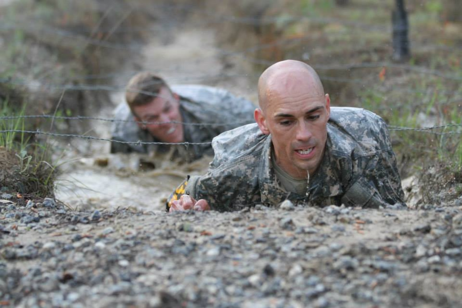 U.S. Soldiers Capt. Robert Killian, Colorado Army National Guard, and 1st Lt. Niclolas Plocar, Wisconsin Army National Guard, negotiate the Malvesti Field Obstacle Course during the 2014 Best Ranger competition at Fort Benning, Ga., April 11, 2014. (U.S. Army photo)