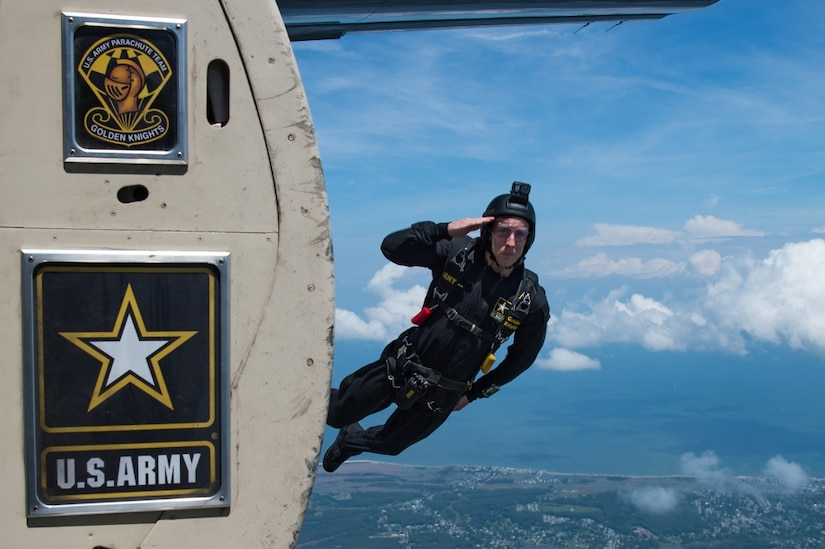 A man jumps out of an airplane.