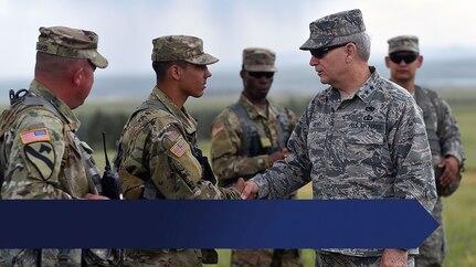 Arkansas Adjutant General Maj. Gen. Mark H. Berry visits Camp Guernsey, Wyoming June 14, 2018 during field artillery training exercise Operation Western Strike