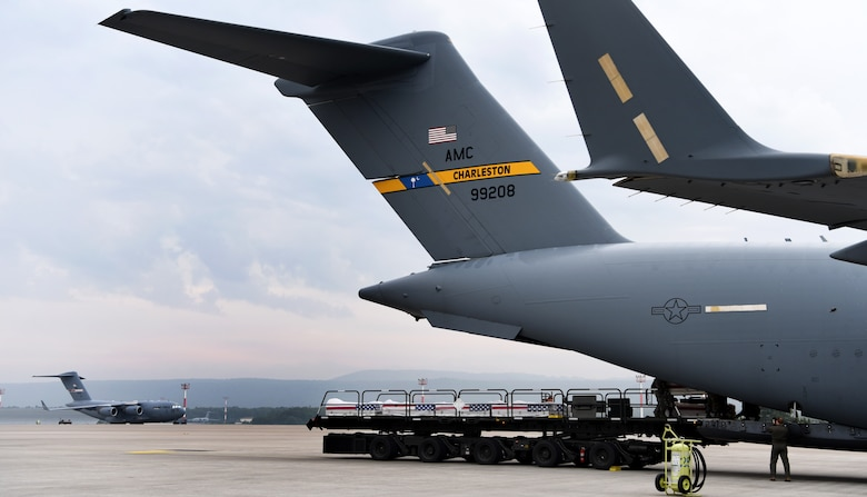 26 transfer cases of WWII human remains get loaded onto a C-17 Globemaster III for a repatriation Sept. 13, 2018, at Ramstein Air Base, Germany. Aircrew from Joint Base Charleston, S.C. was tasked to deliver the remains due to its rapid mobility capabilities.