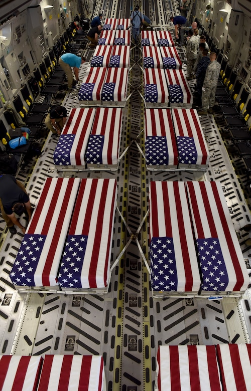 Transfer cases of 26 WWII human remains sit in a C-17 Globemaster III Sept. 14, 2018, at Offutt Air Force Base, Nebraska. Aircrew from Joint Base Charleston, S.C. was tasked to deliver the remains due to its rapid mobility capabilities.