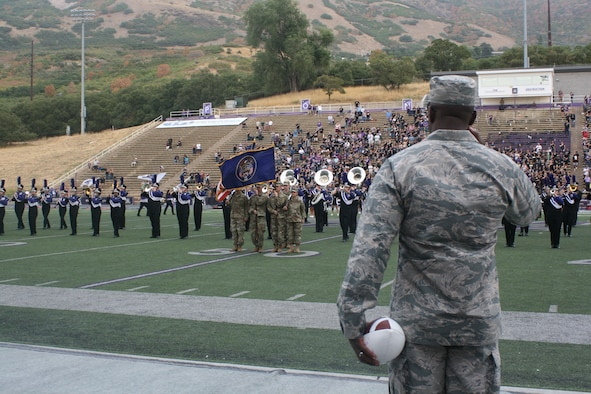 Brig. Gen. Stacey Hawkins, Ogden Air Logistics Complex commander, renders honors to the flag during the National Anthem at the Weber State University Hill Air Force Base Appreciation Game Sept. 15, 2018, at Stewart Stadium in Ogden. Hawkins received the game ball as part of the opening ceremony. (U.S. Air Force photo by Jennifer Eaton)