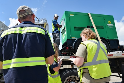 Members of the U.S. Department of Homeland Security Federal Emergency Management Agency receive trucks filled with goods and commodities in support of Hurricane Florence relief efforts Sept. 17, 2018, at Joint Base Charleston's North Auxiliary Airfield located in the town of North, S.C. The NAAF serves as a staging area where humanitarian assets are gathered and sent out to areas affected by Hurricane Florence.