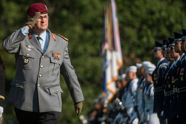 German Inspector Gen. Eberhard Zorn, chief of staff of the Federal Armed Forces, inspects a U.S. Forces Joint Color Guard during a counterpart visit on Whipple Field at Joint Base Myer-Henderson Hall, Sept. 29, 2018.