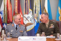 Marine Corps Gen. Joe Dunford, chairman of the Joint Chiefs of Staff, speaks to German Inspector Gen. Eberhard Zorn, chief of staff of the Federal Armed Forces, in the tank during a counterpart at the Pentagon, Sept. 29, 2018.