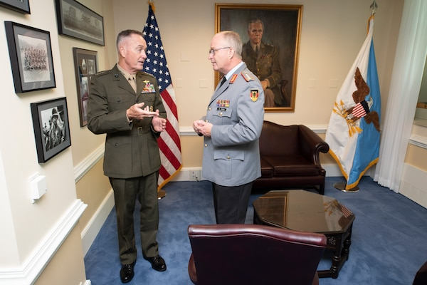 Marine Corps Gen. Joe Dunford, chairman of the Joint Chiefs of Staff, gives German Inspector Gen. Eberhard Zorn, chief of staff of the Federal Armed Forces, a tour of his office at the Pentagon during a counterpart visit, Sept. 29, 2018.