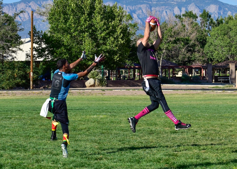 Staff Sgt. Mark Birrenkott, safety for the 58th AMXS flag football team, intercepts a pass intended for Airman 1st Class Patrick Brunson, wide receiver for the WSSS-Joseph football team at Kirtland Air Force Base, N.M., Sept. 17, 2018. Each team participating in the 2018 KAFB Intramural Flag Football season will play 18 games during the regular season. (U.S. Air Force photo by Airman Austin J. Prisbrey)