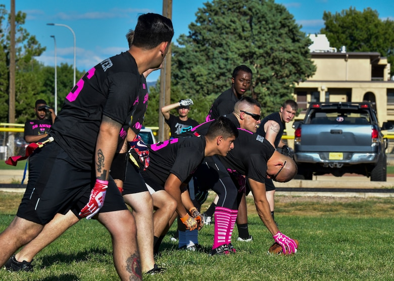Members of the 58th AMXS flag football team line up prior to the snap at Kirtland Air Force Base, N.M., Sept. 17, 2018. There are eight teams participating in the 2018 KAFB Intramural Flag Football season this year. A playoff tournament is scheduled to be held after the regular season to determine an overall winner.  (U.S. Air Force photo by Airman Austin J. Prisbrey)