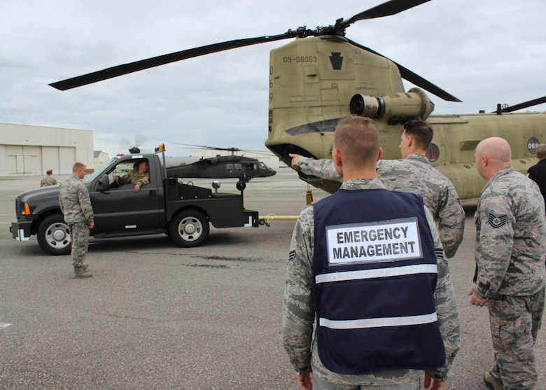 Members of Joint Base Charleston help direct a Pennsylvania Army National Guard Helicopter Aquatic Rescue Team CH-47F Chinook as part of a staging effort for Hurricane Florence rescue operations Sept. 14, 2018.