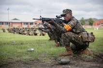 U.S. Marine Corps recruits with Hotel Company, 2nd Recruit Training Battalion, snap in during grass week on Parris Island, S.C. Sept. 12, 2018. The purpose of grass week is to teach recruits shooting positions and weapon safety rules for Tables 1 and 2.